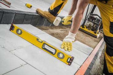Construction Worker Building Concrete Tiles Pathway