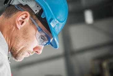 Construction Worker in Hard Hat and Eyes Safety Glasses