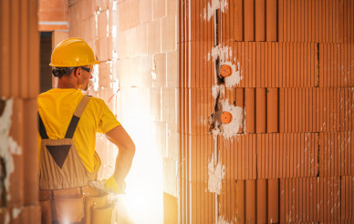 Construction Worker Inside Newly Built Concrete Blocks Building