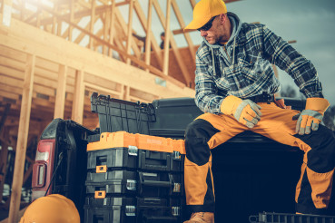 Construction Worker Taking Short Break While Working on House Framing