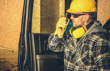 Contractor Making Quick on Site Conversation Using Walkie Talkie
