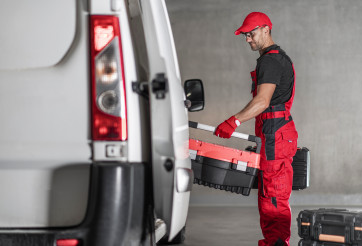 Contractor Worker Loading His Tool Boxes To His Commercial Van