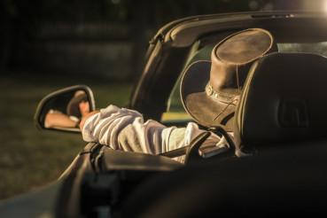 Cowboy in a Convertible Car