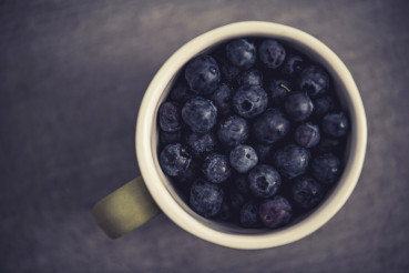 Cup Full of Highbush Blueberries Top View