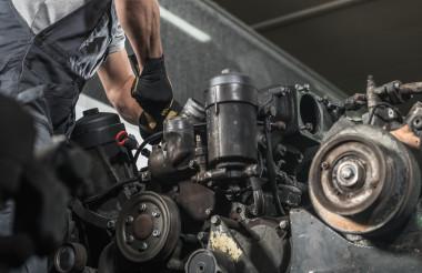 Diesel Specialist Automotive Mechanic Repairs the Engine