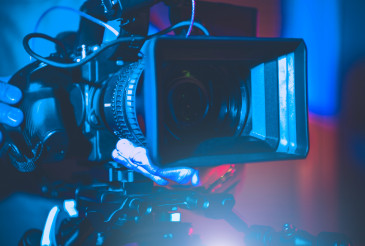 Digital Motion Picture Camera in Hands of Operator