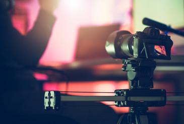 Digital SLR Video Camera Moving on a Slider