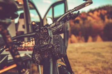 Dirty Mountain Bike and RV Camper Van