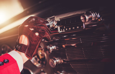 Driver Changing Radio Station In His Classic Car