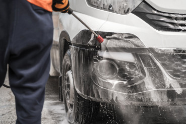 Driver Pressure Washing His Company Van