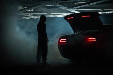 Drug Dealer Awaiting His Client Under Railroad Bridge at Night