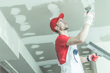 Drywall Ceiling Patching by Remodeling Worker