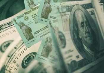 Economy Impact Payment Checks Concept