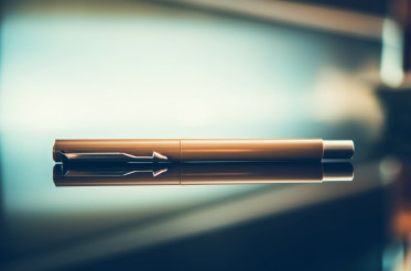 Elegant Pen on Glassy Desk