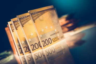 Euro Banknotes on Glassy Table