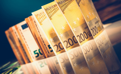 Euro Bills on Reflective Table