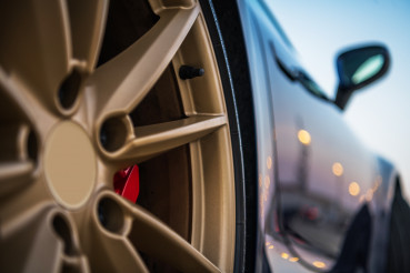 Close Up Of Golden Tire Rim Of Exotic Car.