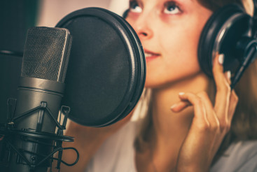 Female Voiceover Speaker in Recording Studio