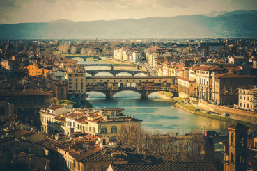Cityscape Of Florence Italy With Mountain Range.