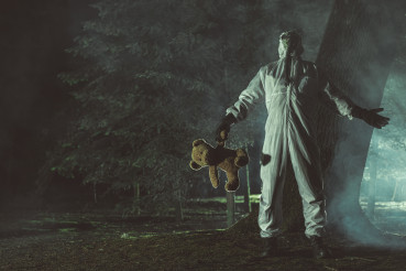 Frustrated Men in Hazmat Suit and Biohazard Mask Keeping Teddy Bear