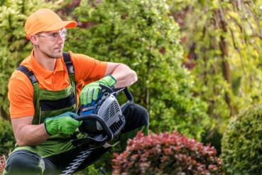 Garden Worker with Trimmer