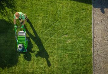 Gardener Moving Lawn