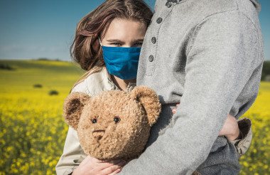 Girl in Breathing Face Mask Hugging Her Dad and Teddy Bear