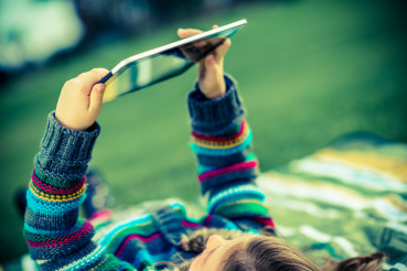 Girl in Park with Tablet