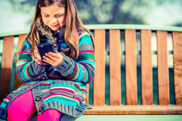 Girl on Bench with Smartphone
