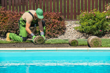 Grass Turfs Installation Along Side of Swimming Pool