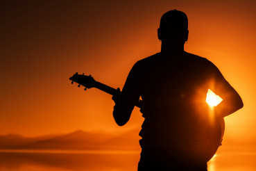 Guitar Playing at Sunset