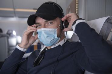 Happy Business Class Flight Passenger with Headphones