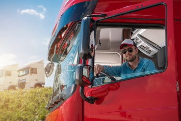 Happy Caucasian Truck Driver in His 30s