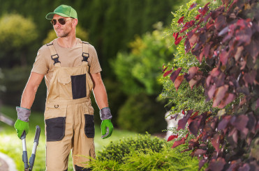 Happy Professional Gardener with Scissors in His Hands