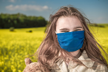 Happy Teenager Caucasian Girl Wearing Blue Face Mask