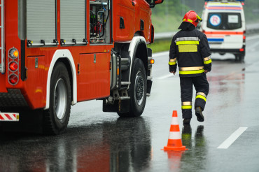 Highway Traffic Accident Site Firefighter Securing Traffic