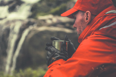 Hiker Warming Up Drinking Hot Tea