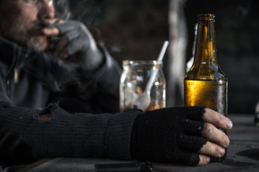 Homeless Alcoholic Drinking Another Bottle of Bear
