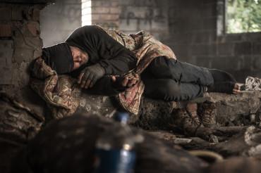 Homeless Men Sleeping Inside Abandoned House