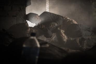 Homeless Men Sleeping Inside House Ruins