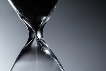 Hourglass Countdown in a Dark Close Up