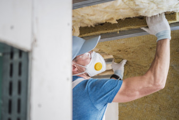 House Insulating by Worker