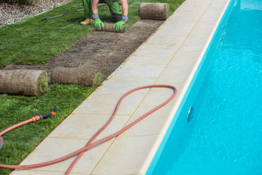 Installing Nature Grass Turfs Next to Outdoor Swimming Pool