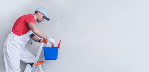 Interior Painter Contractor Worker on a Ladder