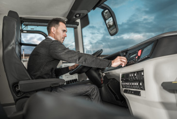 International Motor Coach Bus Driver Preparing For Another Trip
