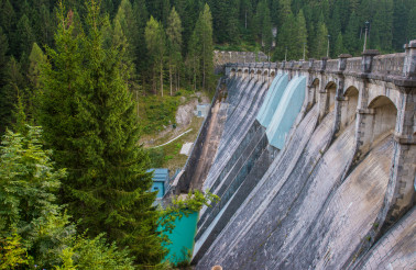 Dam In Forest In Northern Italy.