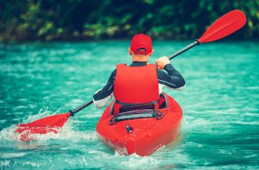 Kayaker on the Scenic Lake Trip
