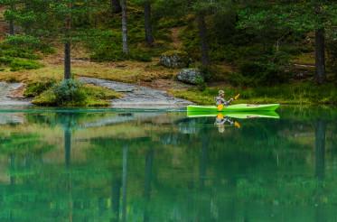 Kayaker Taking Glacial Lake Trip