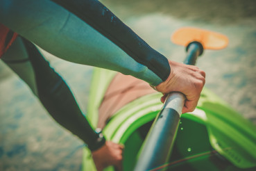 Kayaker with Paddle in Hand Close Up