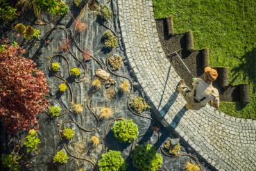Landscape Specialist Finishing Newly Developed Garden